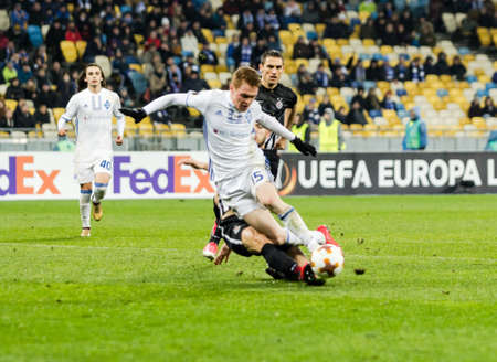 Kyiv, Ukraine – December 7, 2017: Viktor Tsygankov of Dynamo Kyiv fighting for the ball with Nemanja Miletic of Partizan during UEFA Europa League match at NSC Olimpiyskiy stadium. Stock Photo - 91643569