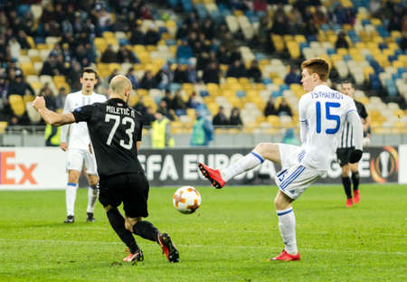 Kyiv, Ukraine – December 7, 2017: Viktor Tsygankov of Dynamo Kyiv fighting for the ball with Nemanja Miletic of Partizan during UEFA Europa League match at NSC Olimpiyskiy stadium. Redakční