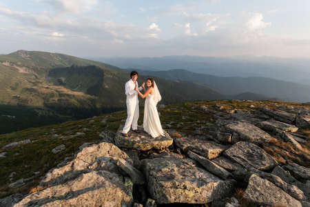 Young love couple celebrating a wedding in the mountain