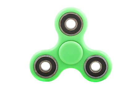 Green spinner stress relieving toy isolated on white background.