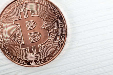 Bitcoin coin on wooden background. New virtual money. Mining of crypto-currencies. Business and Trading concept.