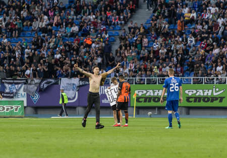 Kyiv, Ukraine - May 19, 2018: The fan ran to the field during the match. Ukrainian Premier League match Dynamo Kyiv – Shakhtar Donetsk at Dynamo Kyiv stadium.