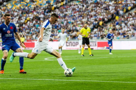 Kyiv, Ukraine - August 14, 2018: Denys Garmash shoots the ball during UEFA Champions League match Dynamo Kyiv – Slavia Prague at NSC Olympic stadium in Kyiv, Ukraine. Redakční