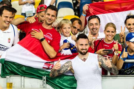 Kyiv, Ukraine - August 14, 2018: Tamas Kadar with his fans celebrates victory against Slavia, UEFA Champions League match Dynamo Kyiv – Slavia Prague at NSC Olympic stadium in Kyiv, Ukraine.