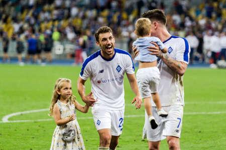 Kyiv, Ukraine - August 14, 2018: Josip Pivaric with his kids celebrates victory against Slavia, UEFA Champions League match Dynamo Kyiv – Slavia Prague at NSC Olympic stadium in Kyiv, Ukraine.