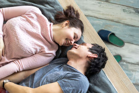 Romantic couple. Beautiful young loving couple embracing in bed at home. Reklamní fotografie