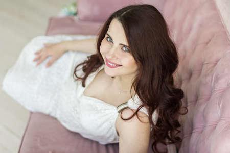 Pregnancy, motherhood, people and expectation concept - close up of happy pregnant woman with big belly at home.