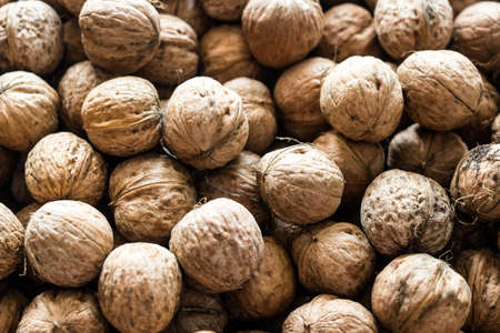 Natural walnut background pattern texture. Natural food in-shell nuts walnuts pattern backdrop.