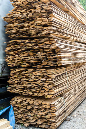 Stack of natural rough wooden boards. Wooden boards, lumber, industrial wood. Industrial timber Stock Photo