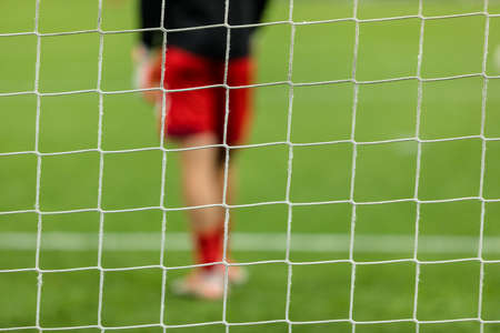 Soccer net with blured player