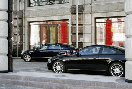 Two modern cars business-class are parked beside calve Imagens