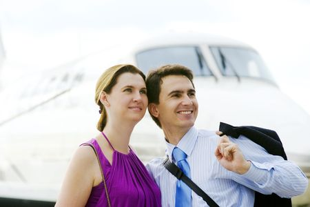 to expect: Businessman and his wife expect boarding on plane Stock Photo