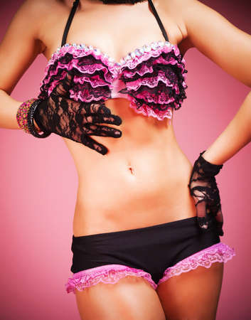 Young female dancer wearing pink and black lace and lingerie Stock Photo