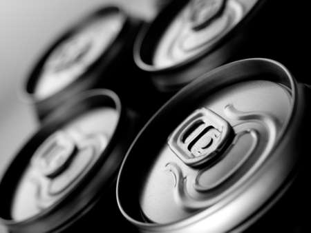 Top part of beer cans, close up view photo