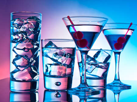 Variety of cocktails on pink and blue background Stock Photo - 12974499