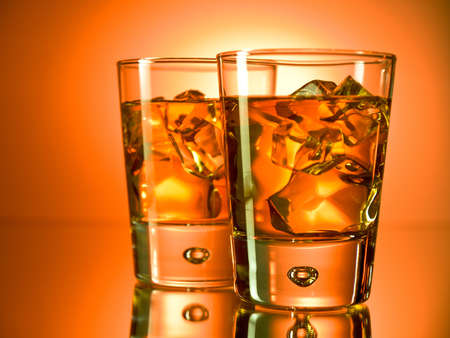 amber: Two glasses of whiskey on the rocks