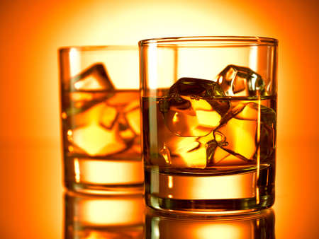 two object: Two glasses of whiskey on the rocks