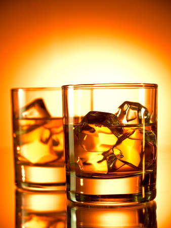 icecube: Two glasses of whiskey on the rocks