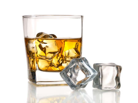 Glass of whiskey on the rocks and ice cubes, isolated on whte photo