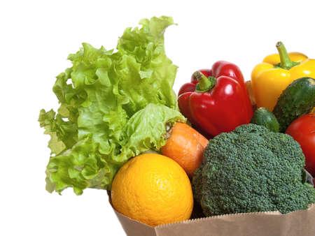 Bag full of vegetables, isolated on white photo