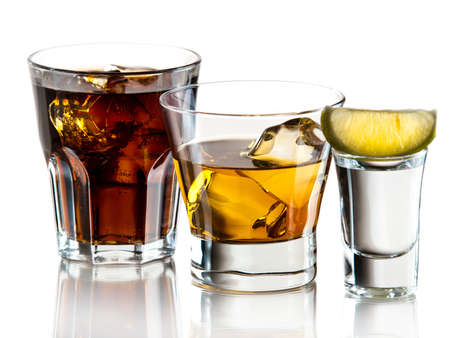 Cuba libre, whiskey on the rocks and tequila shot Stock Photo