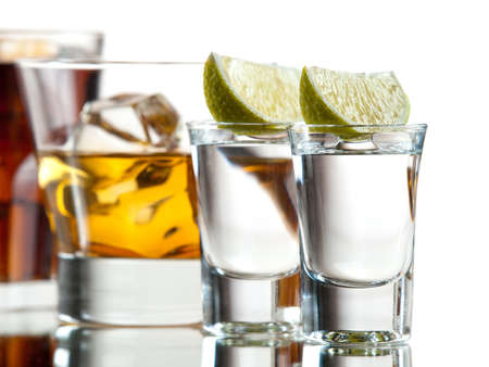 Zwei Tequila, Whisky on the rocks und Cuba libre Standard-Bild - 16452870