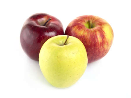 Three apples arranged on a white background photo