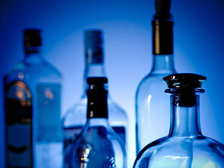 vodka bottle: Various bottles at a bar arragged in rows Stock Photo