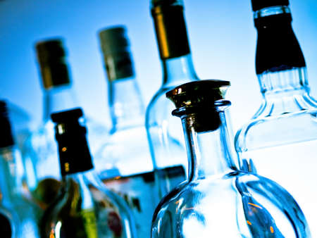 Various bottles at a bar arragged in rows Stock Photo