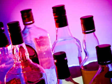 corked: Various bottles at a bar arragged in rows Stock Photo