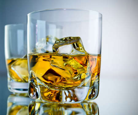 whisky glass: Two glasses of whiskey on the rocks