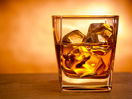 icecube: Glass of whiskey on the rocks Stock Photo