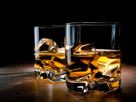 Two glasses of whisky on the rocks