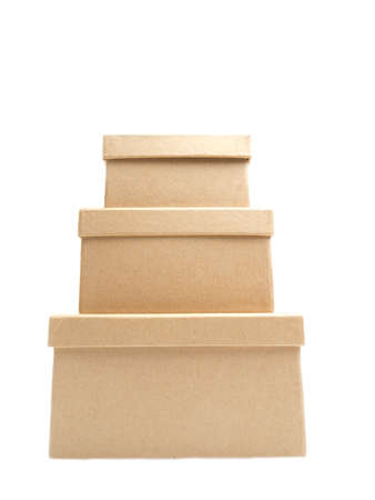 Three square paper boxes on white background, one on top of another photo