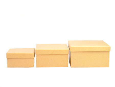 Three square paper boxes on white background photo
