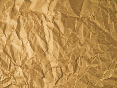 scrunch: Yellow wrinkled paper as a background