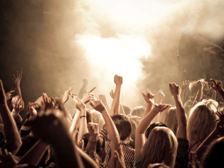 adulation: Crowd at a concert, hands up  High ISO  Stock Photo