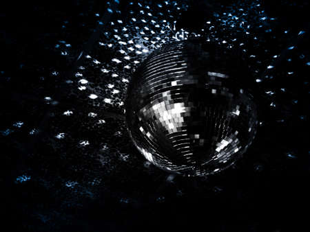 Mirrorball reflections on the ceiling of a night club photo
