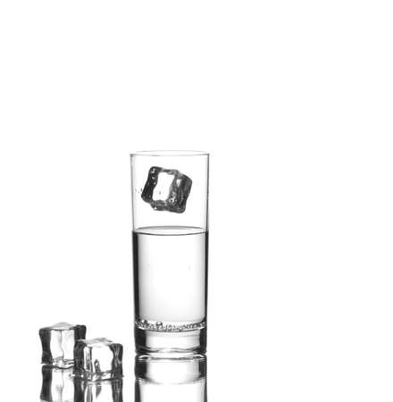 Ice cube falling in a glass of sparkling water photo