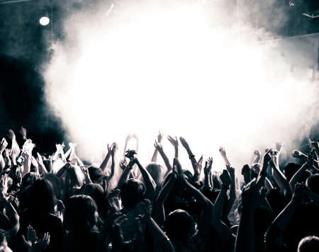 Concert crowd, hands up, toned photo