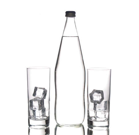 quench: Glass bottle of water and two glasses with ice cubes, isolated