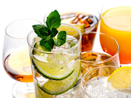 Various alcoholic cocktails on white background