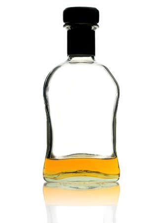casi: Botella de whisky casi vac�a en el fondo blanco Foto de archivo