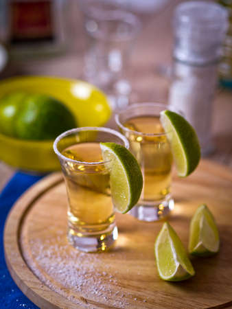 Tequila shots with wedges of lime and salt Reklamní fotografie
