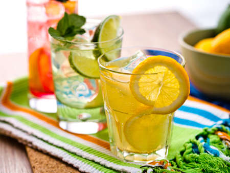 ice lemon tea: Three refreshing cocktails with lime, mint, orange and blackberry