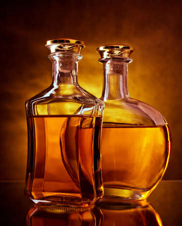 whisky bottle: Two bottles of whiskey and brandy Stock Photo