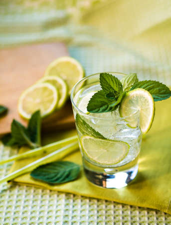 Refreshing summer cocktail with lime and mint photo