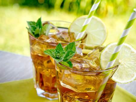 iced tea: Refreshing peach, lime and mint ice tea served outdoors