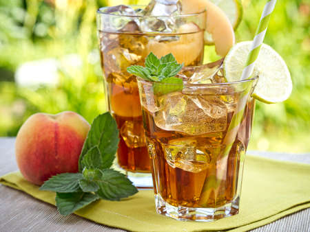 Refreshing peach, lime and mint ice tea served outdoors