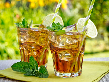 ice tea: Refreshing peach, lime and mint ice tea served outdoors